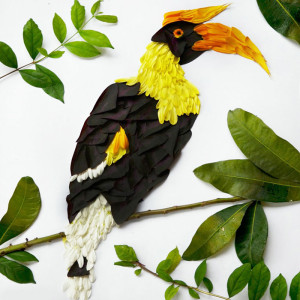 Red Hong Yi, hornbill made of chrysanthemums, germeras and purple shamrocks